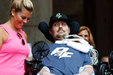 FILE - In this Sept. 5, 2017, file photo, Pete Frates, right, who inspired the ice bucket chall ...
