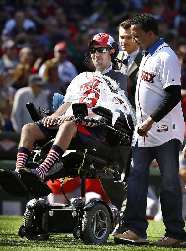 FILE - In this April 13, 2015, file photo, Pete Frates, center, former Boston College baseball ...