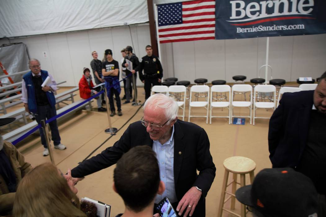 Vermont Sen. Bernie Sanders speaking with members of the crowd after a campaign event in Carson ...
