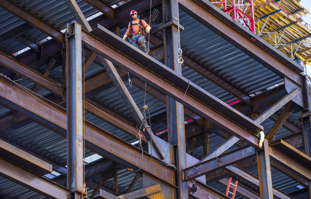 Workers secure another beam brought up during a construction tour of the Circa on Monday, Dec. ...