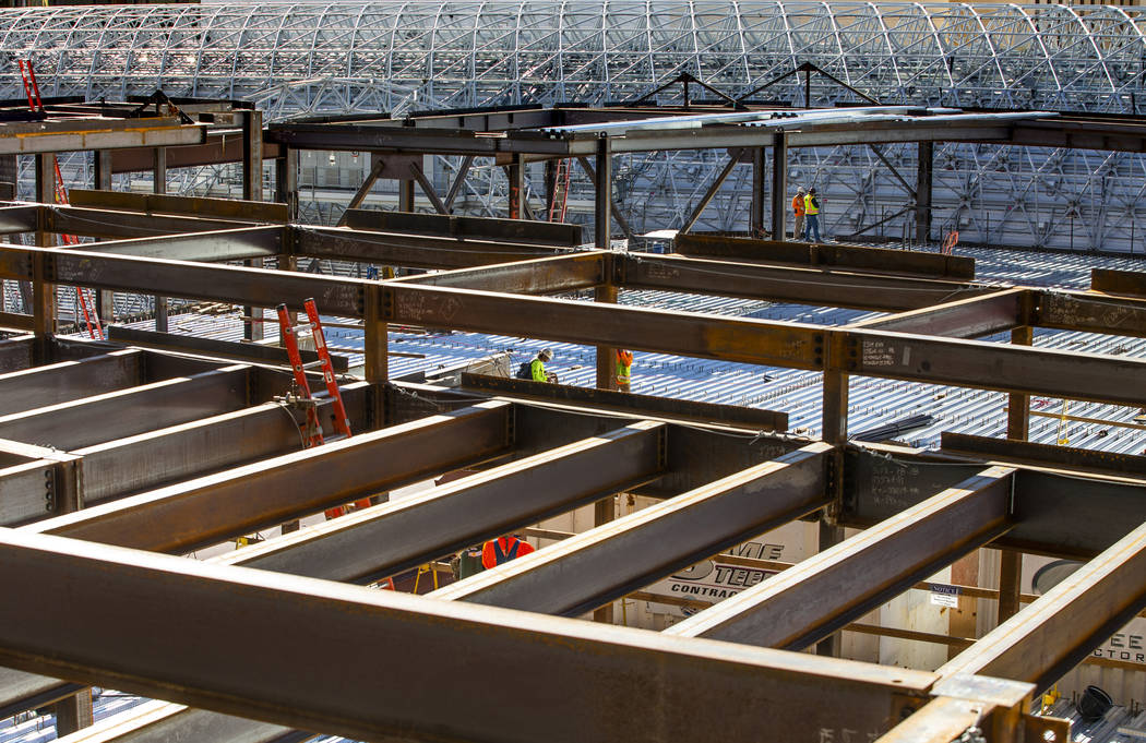 Steel continues to be erected in the pool area during a construction tour of the Circa on Monda ...