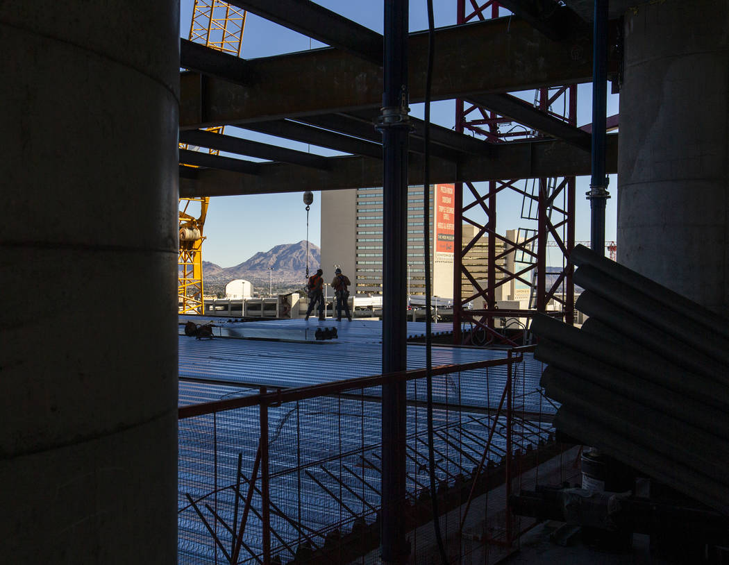 Workers ready for another beam to be brought up during a construction tour of the Circa on Mond ...