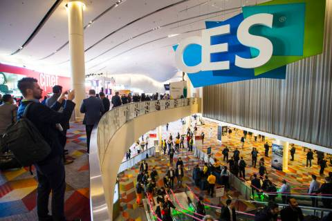 CES attendees make their way to the Sands Expo and Convention Center in Las Vegas, Jan. 9, 2019 ...