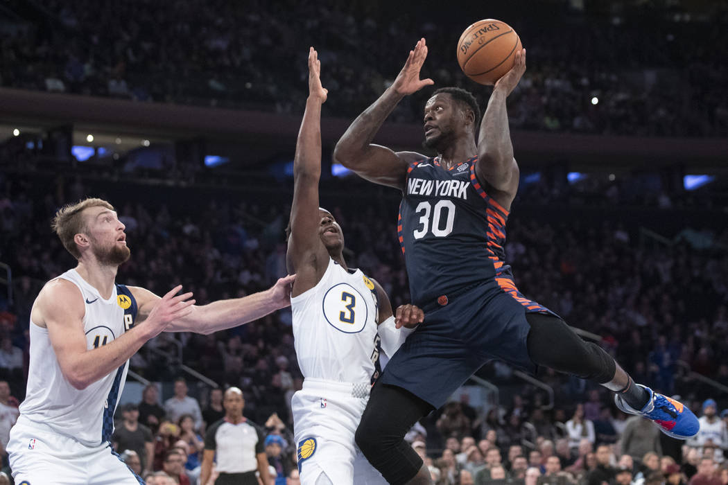New York Knicks forward Julius Randle (30) goes to the basket against Indiana Pacers guard Aaro ...