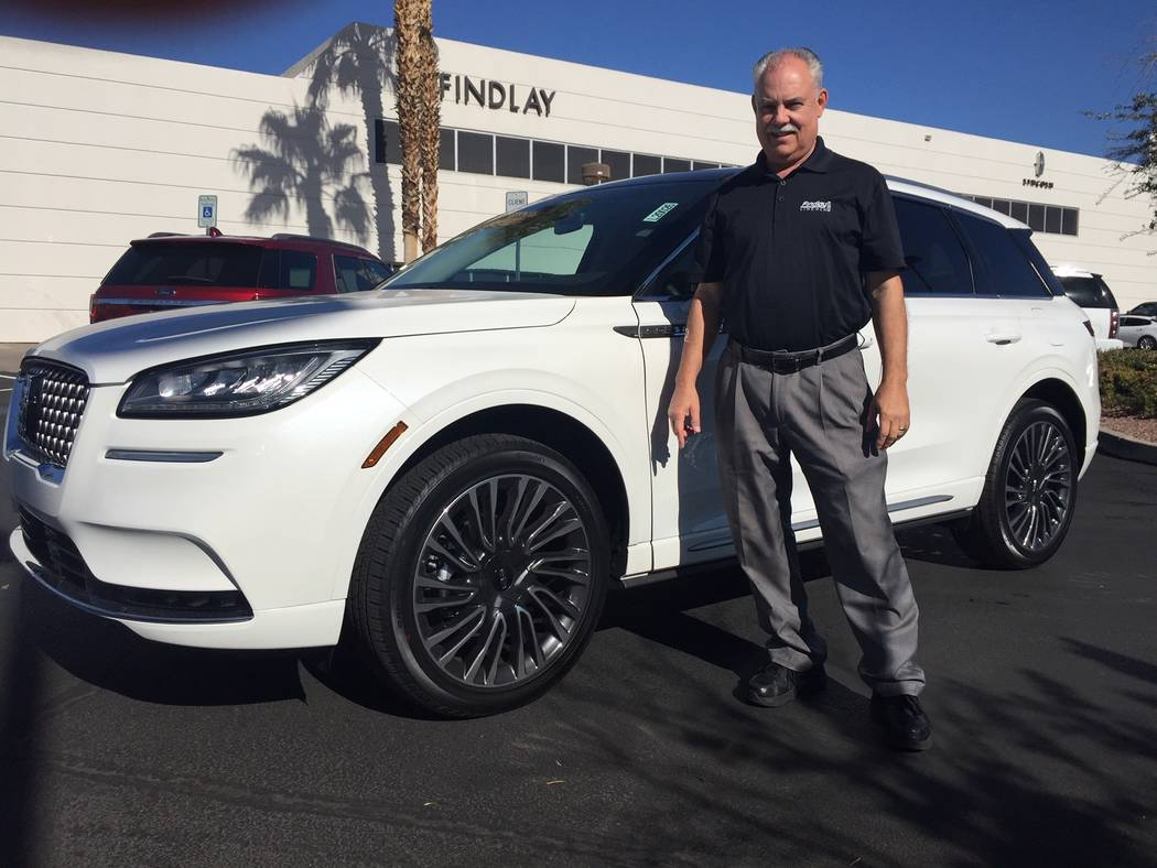 Findlay Lincoln sales consultant Jeff Lamper is seen with a 2020 Lincoln Corsair sport utility ...