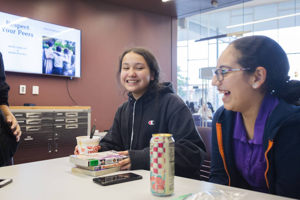 Martin Middle School students Nicole Valenzuela, 12, left, and Aranca Medina, 12, hangout in th ...