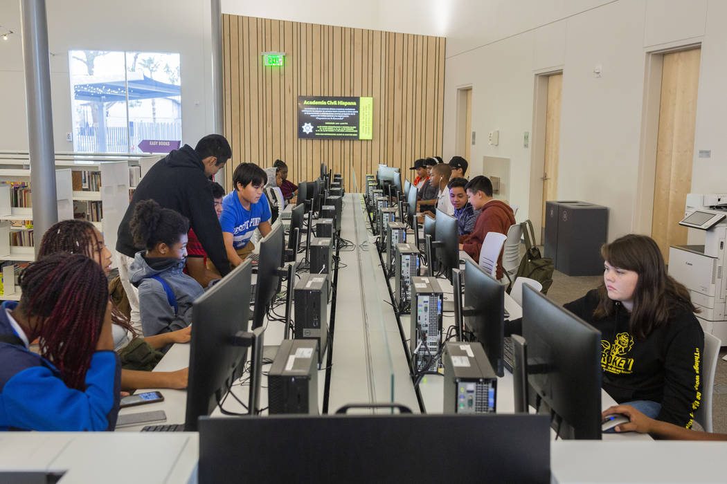 Youth do different actives in the computer lab at the East Las Vegas Library in Las Vegas on Tu ...
