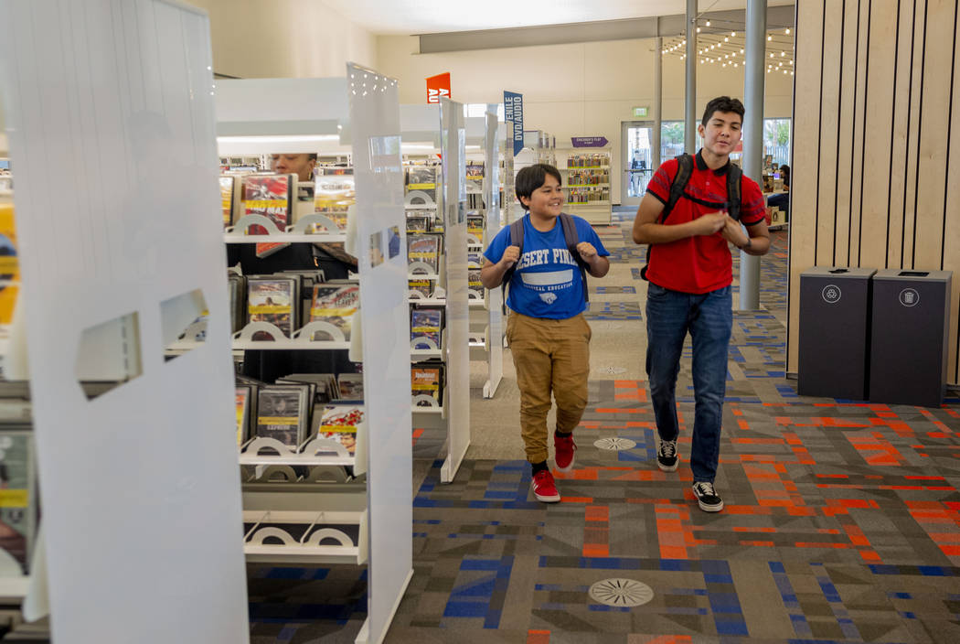 Desert Pines High School students Arturo Ramirez, 14, left, and Walter Enriquez, 16, walk throu ...