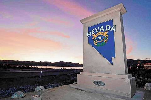 "A ""Welcome to Nevada"" monument sign similar to the one shown along U.S. Highway 395 a ..."