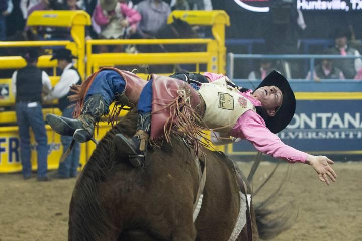 Tilden Hooper makes his run during National Finals Rodeo. Benjamin Hager Las Vegas Review-Journal