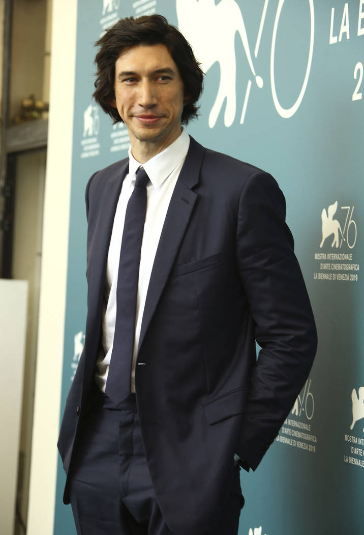 Actor Adam Driver poses for photographers at the photo call for the film 'Marriage Story' at th ...