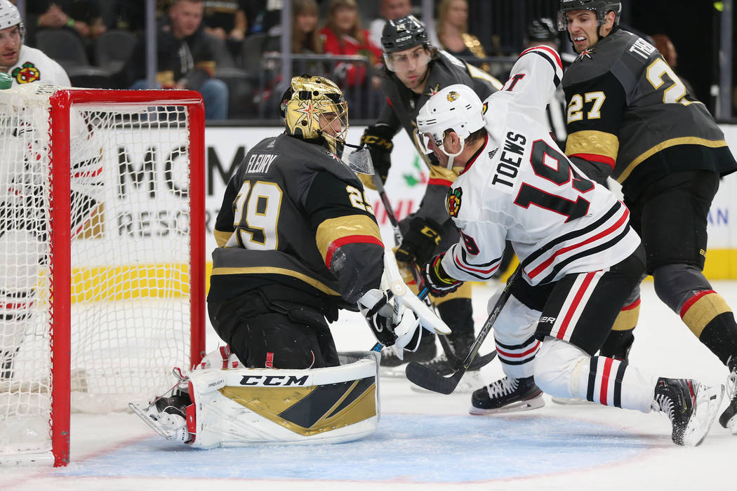 Vegas Golden Knights goaltender Marc-Andre Fleury (29) and defenseman Shea Theodore (27) defend ...