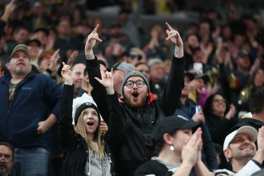 Fans celebrate a score by the Vegas Golden Knights in the second period during their NHL hockey ...