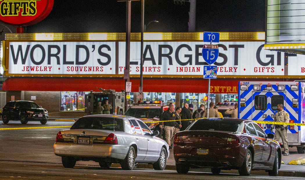 Las Vegas police gather in the parking lot as they work a barricade situation of a woman with a ...
