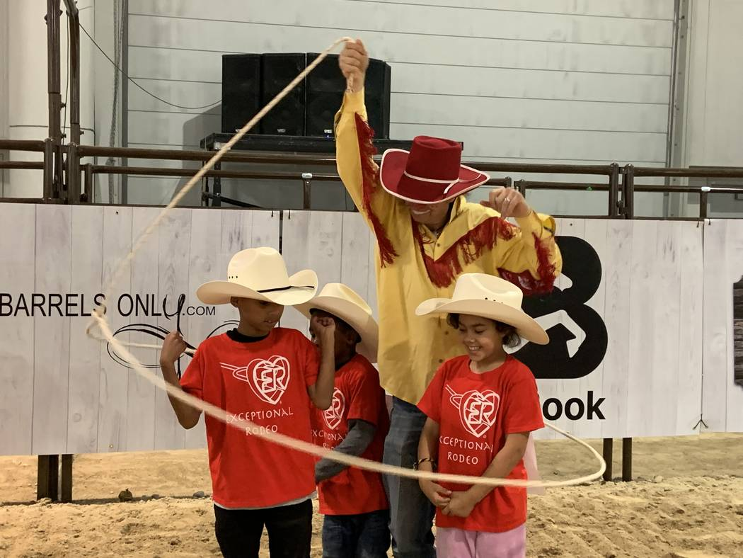 Wrangler NFR rodeo clown John Harrison displays his trick-roping skills to a group of local spe ...