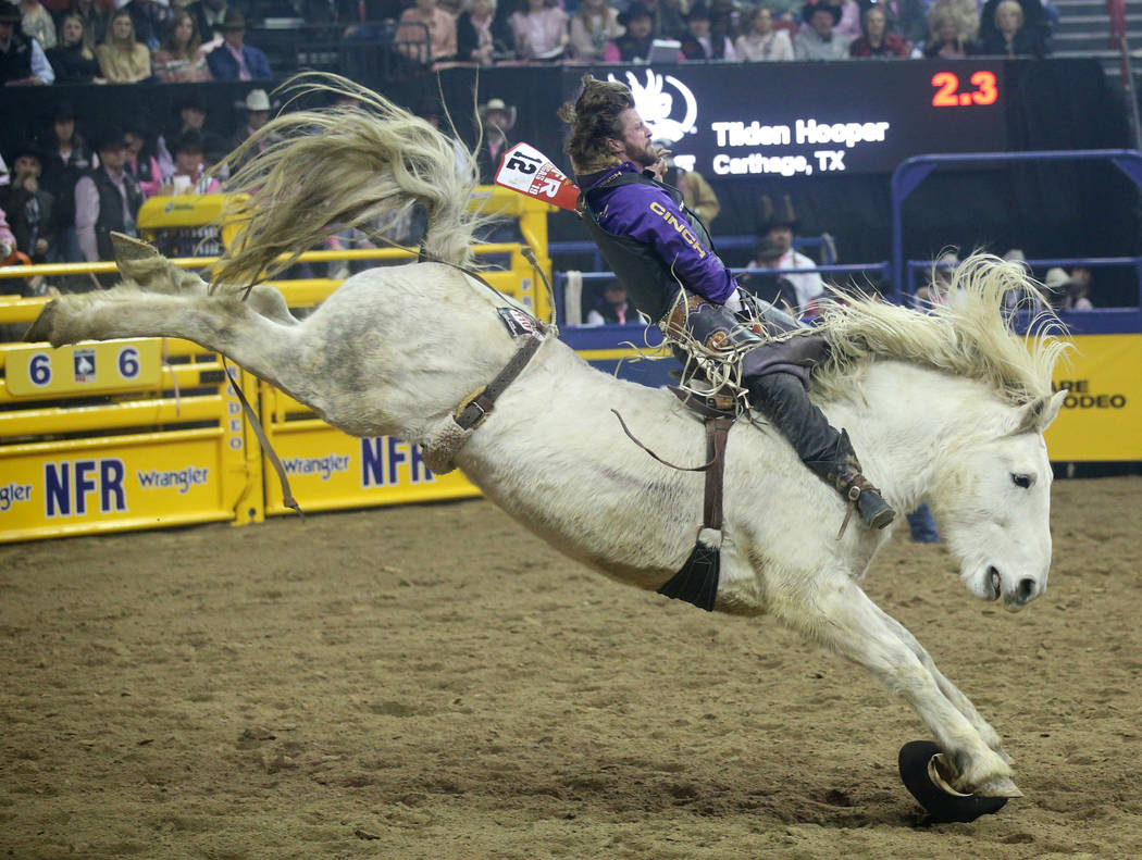 Tilden Hooper of Carthage, Texas rides Virgil during Bareback Riding in the fifth go-around of ...