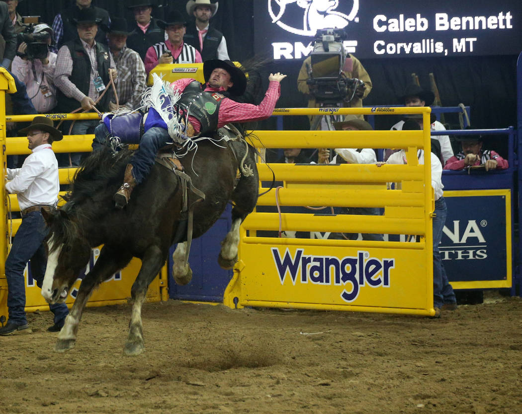Caleb Bennett of Corvallis, Mont. rides Stevie Knicks during Bareback Riding in the fifth go-ar ...