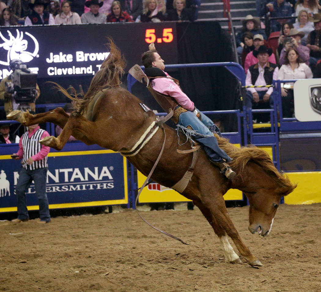 Jake Brown of Cleveland, Texas rides Good time Charlie during Bareback Riding in the fifth go-a ...