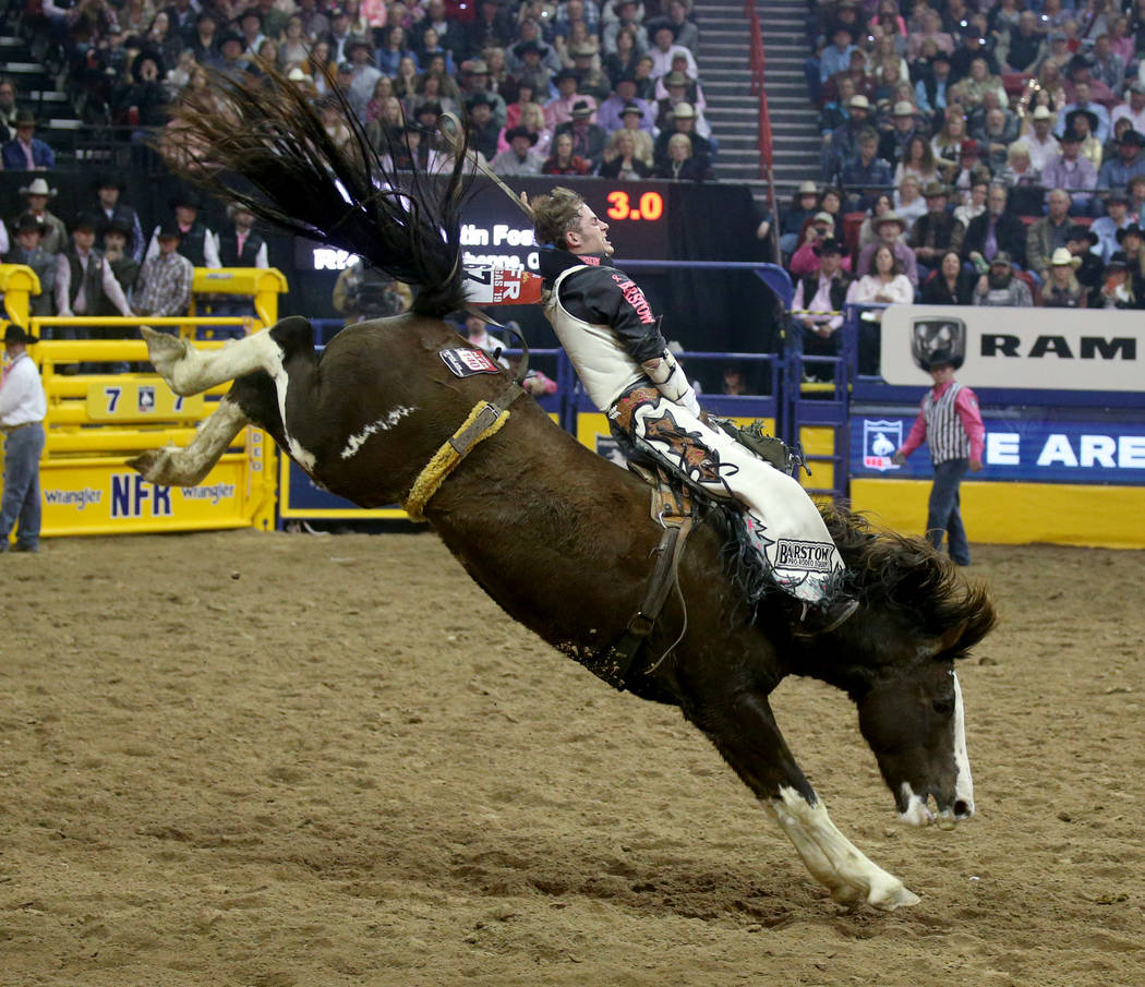 Austin Foss of Terrebonne, Ore. rides Blessed Assurance during Bareback Riding in the fifth go- ...