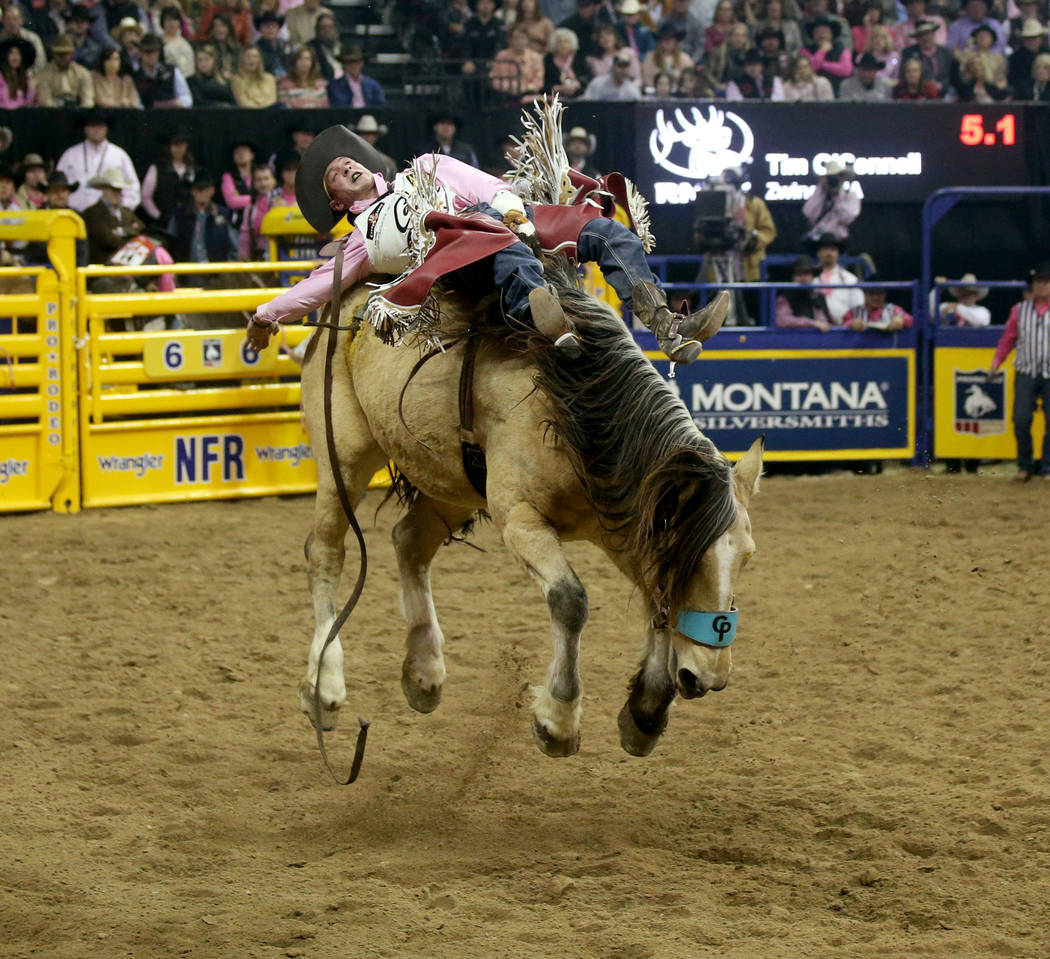 Tim O'Connell of Zwingle, Iowa rides Uncapped during Bareback Riding in the fifth go-around of ...