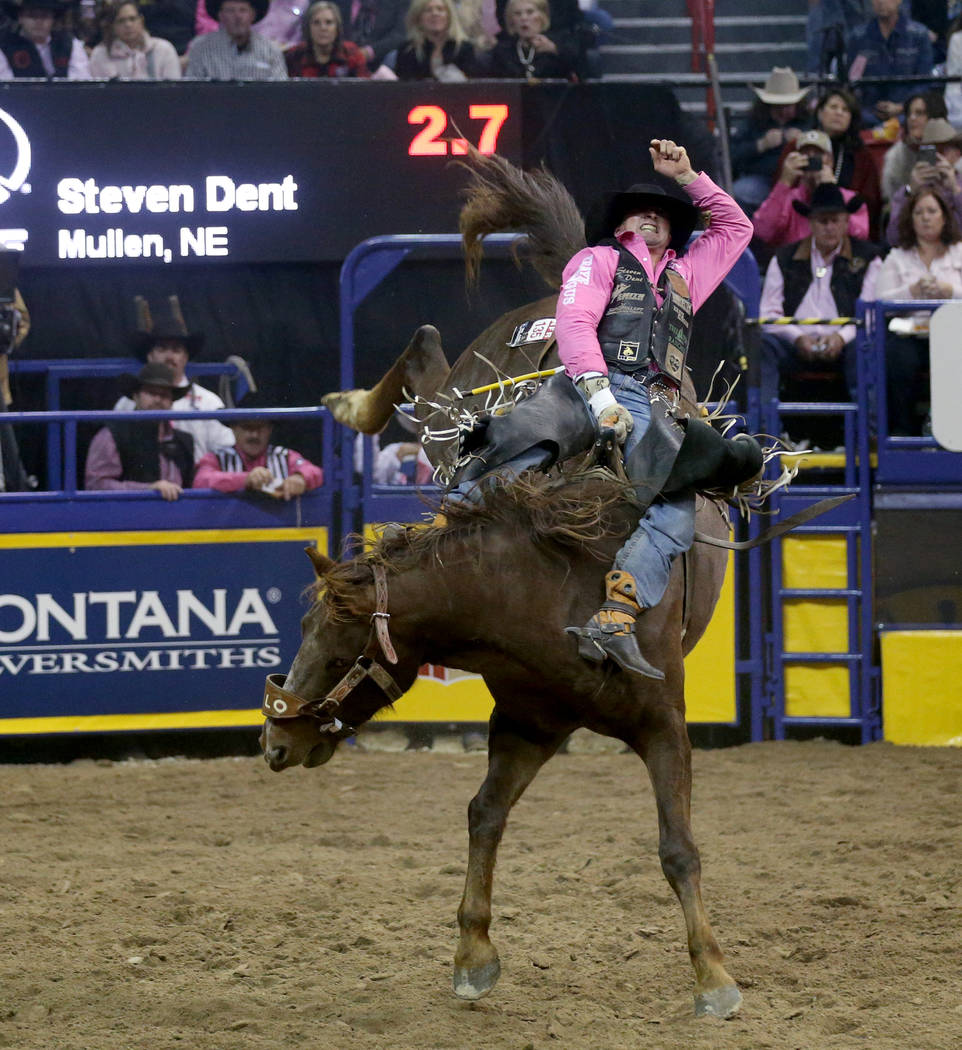 Steven Dent of Mullen, Neb. rides Redzilla during Bareback Riding in the fifth go-around of the ...