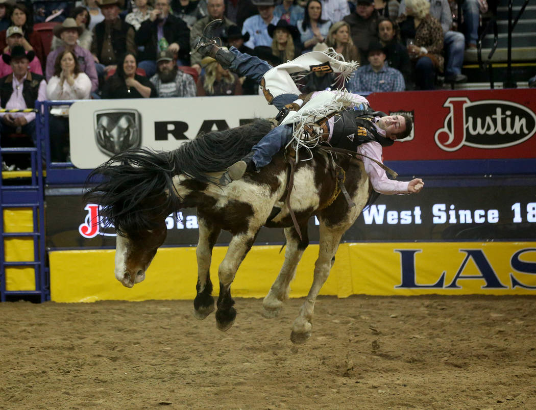 Kaycee Feild of Genola, Utah rides Life Jacket during Bareback Riding in the fifth go-around of ...