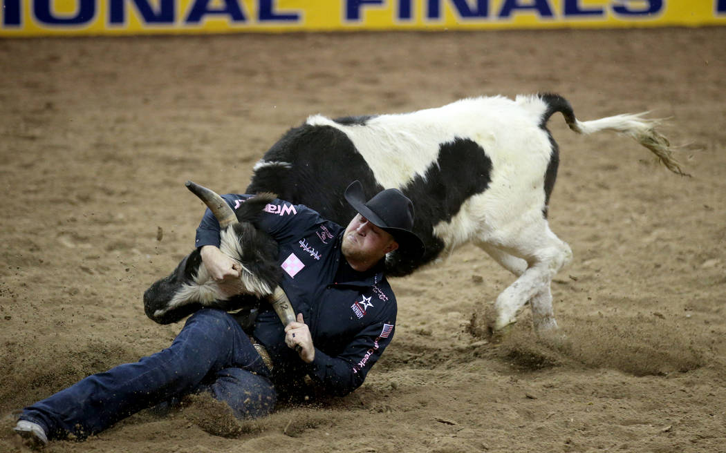 Will Lummus of West Point, Miss. competes in Steer Wrestling during Bareback Riding in the fift ...