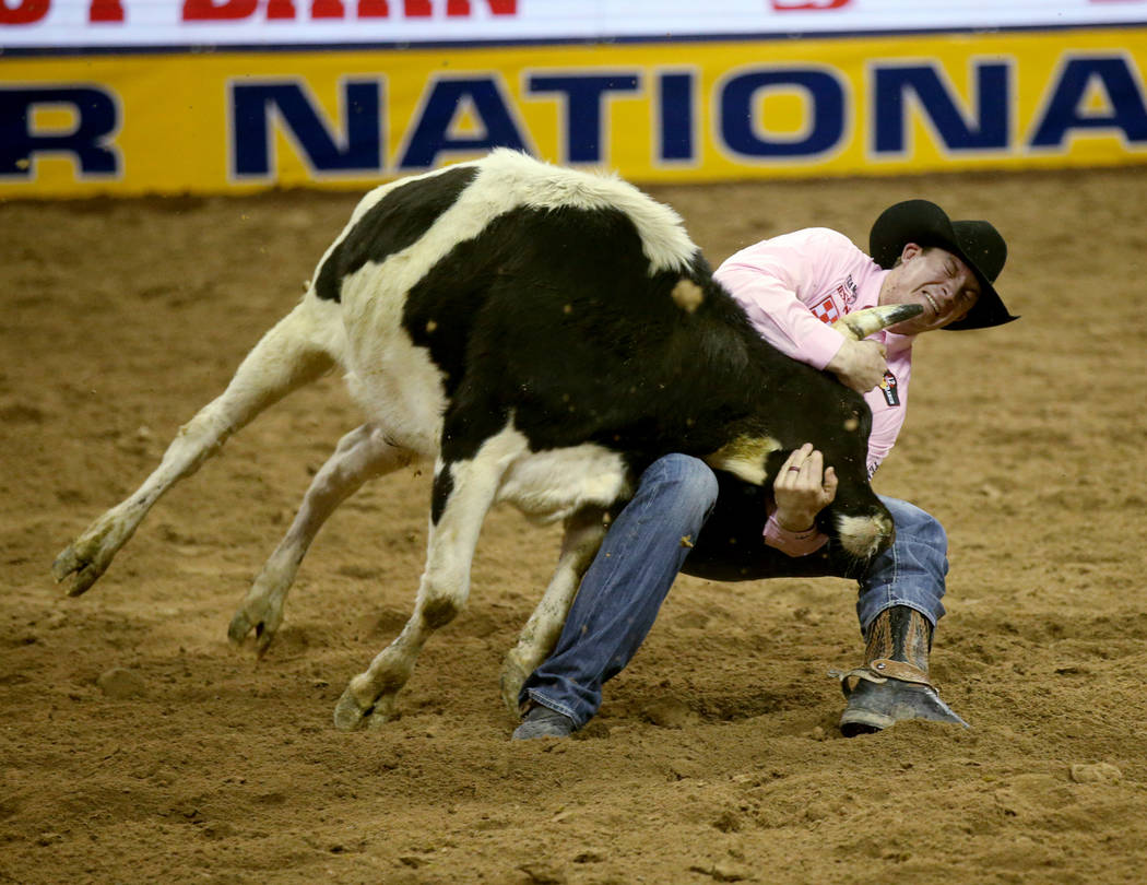 Ty Erickson of Helena, Mont. competes in Steer Wrestling during Bareback Riding in the fifth go ...