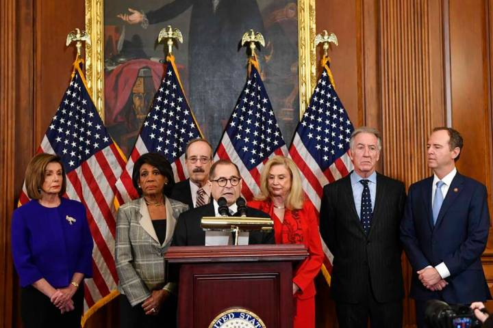 Members of the U.S. House of Representatives unveil articles of impeachment against President D ...