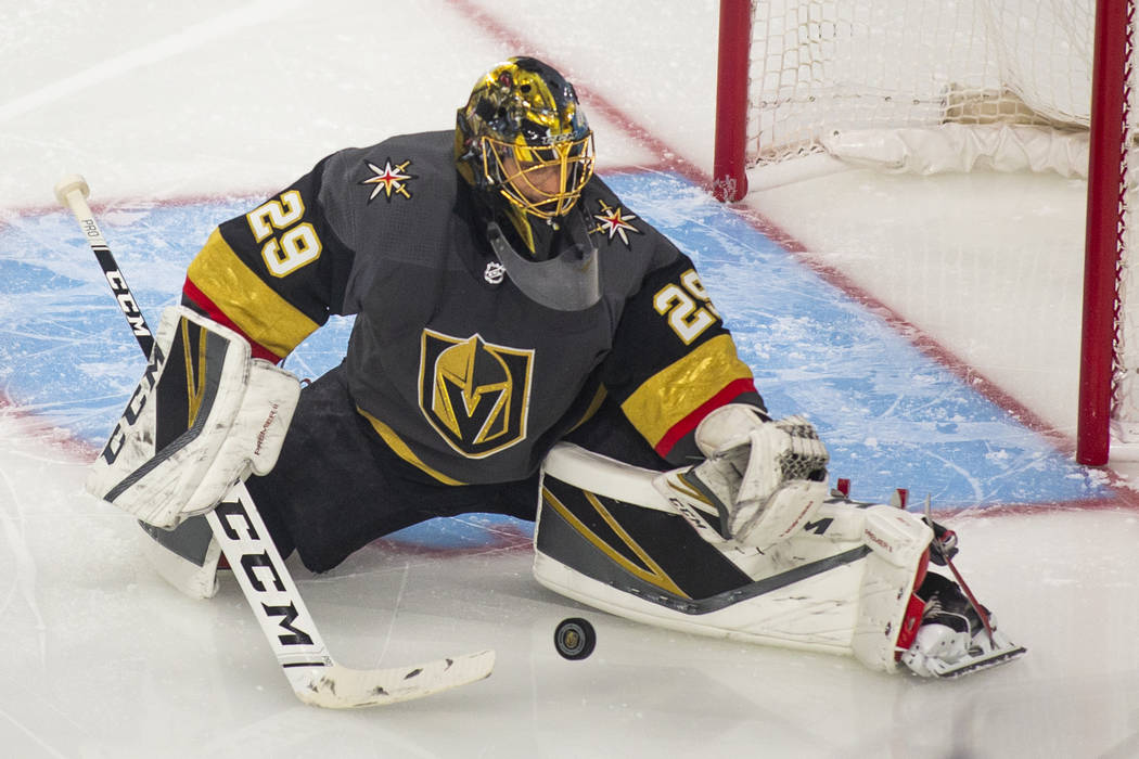 Golden Knights goaltender Marc-Andre Fleury (29) makes a stop during the first period of Game 4 ...