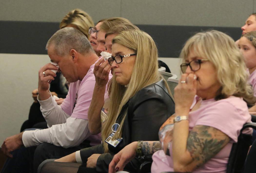 Steven Minkler, left, and his wife, Jamie, parents of murder victim Matthew Minkler, 17, weep d ...