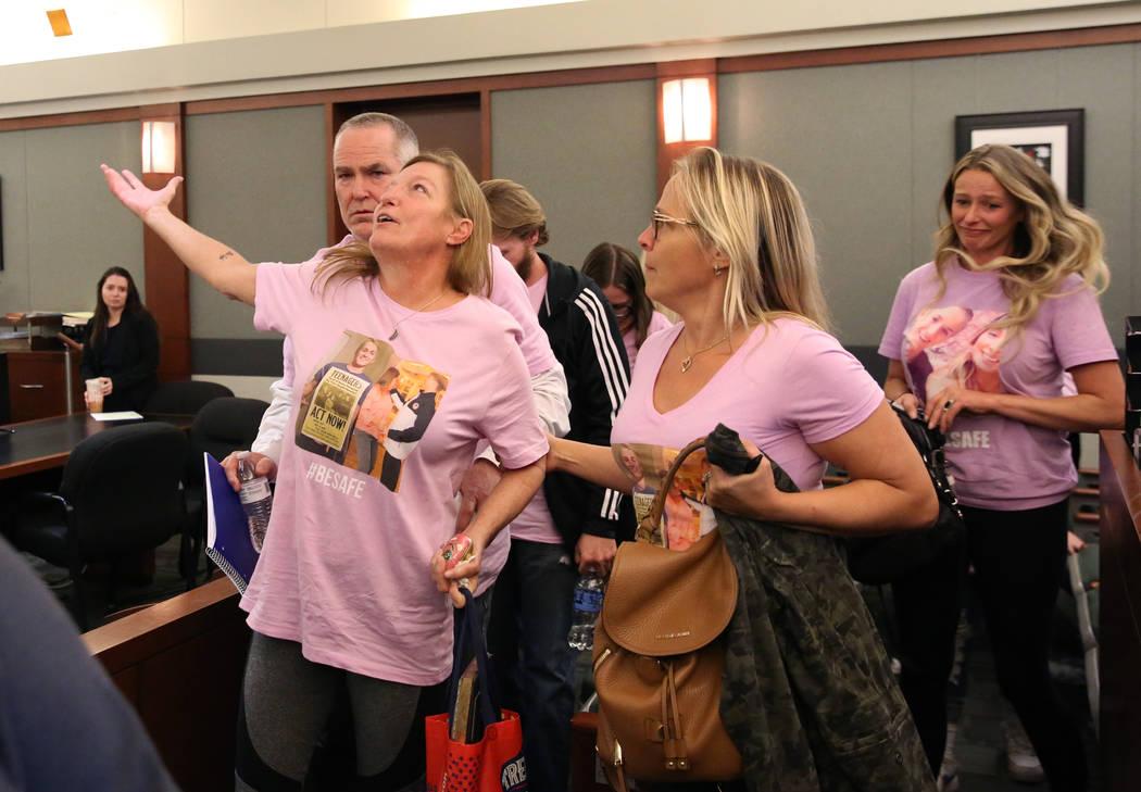 Jamie Minkler, left, mother of murder victim Matthew Minkler, 17, reacts as her husband, Steven ...