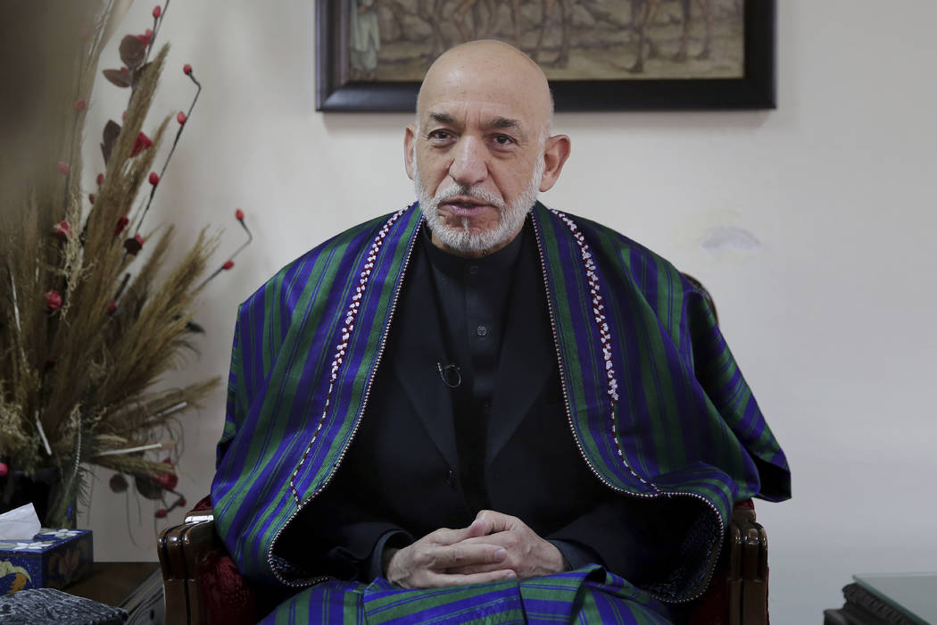Former Afghan President Hamid Karzai speaks during an interview with The Associated Press, in K ...
