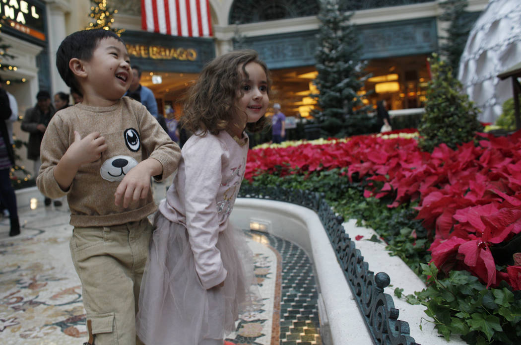 Alden Sutheno, 3, and Tala Taherzadeh, 3, wait for the toy train at the Bellagio Conservatory & ...