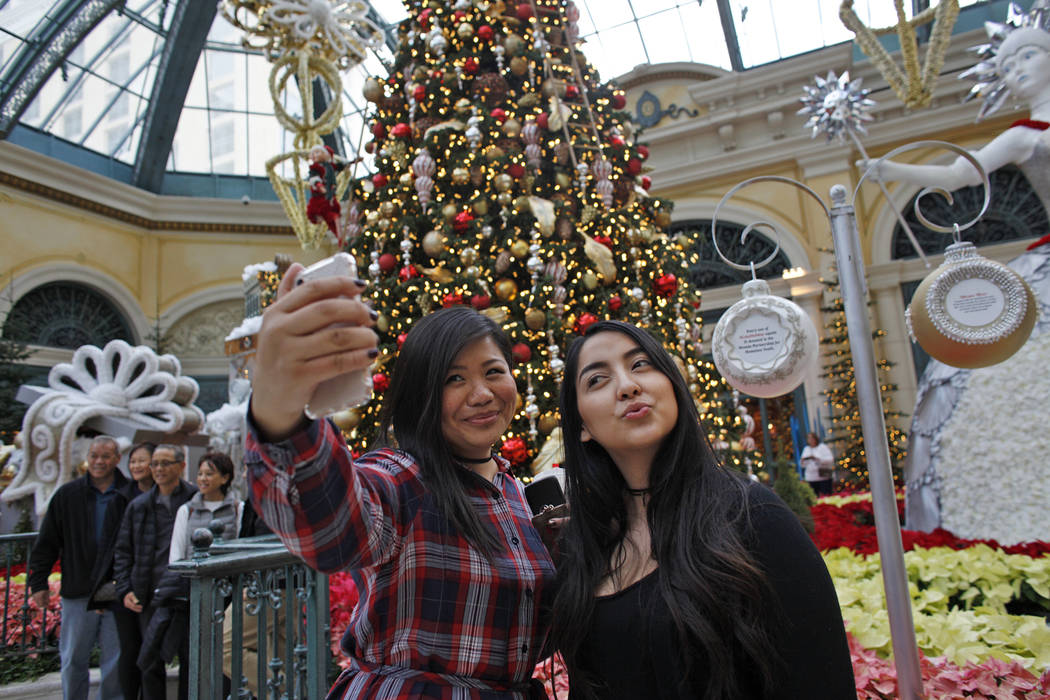 Shu Pan, left, and Michelle Leon take a selfie at the Bellagio Conservatory & Botanical Garden ...