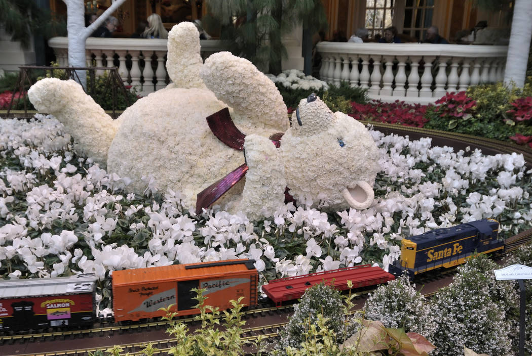 A baby polar bear sculpture, created using white carnations to make up its snowy coat, is displ ...