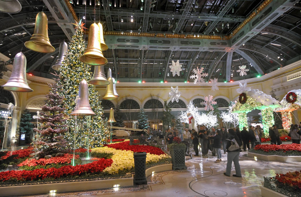 Visitors walk through the 2011 Winter Holiday Exhibit at the Bellagio Conservatory & Botanical ...
