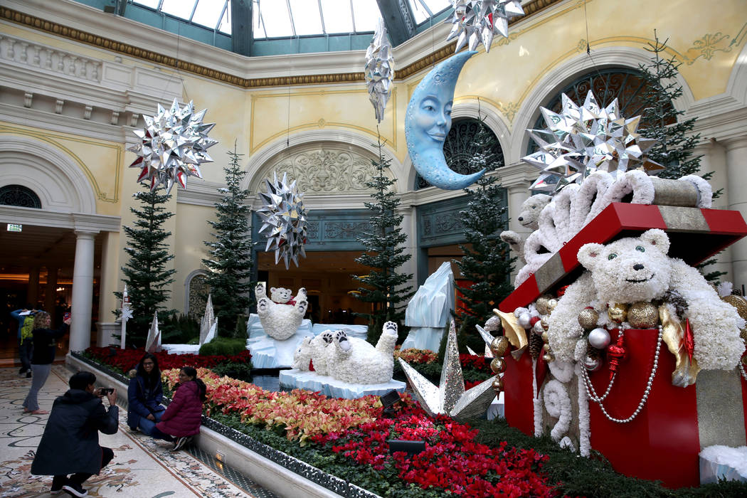 Guests check out the Majestic Holiday Magic at the Bellagio Conservatory & Botanical Garden in ...