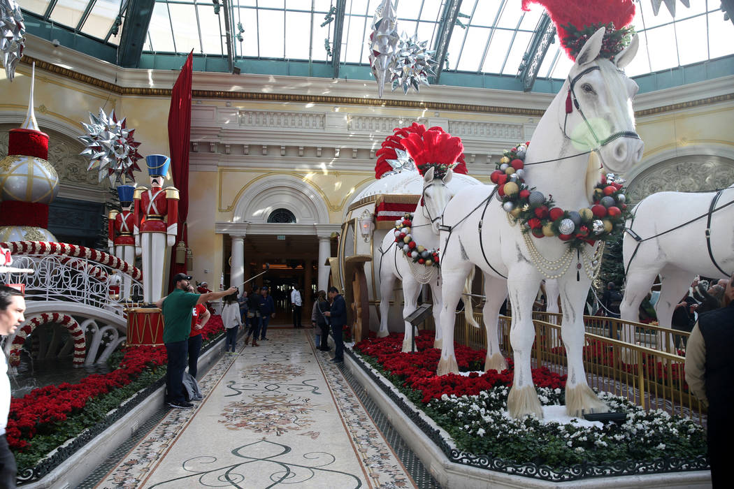 Guests check out the Majestic Holiday Magic at the Bellagio Conservatory & Botanical Gardens in ...