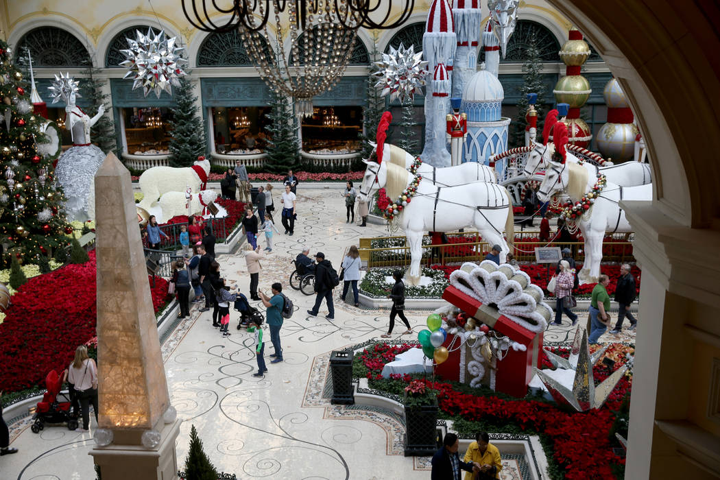 Guests check out the Majestic Holiday Magic at the Bellagio Conservatory & Botanical Garden Dec ...