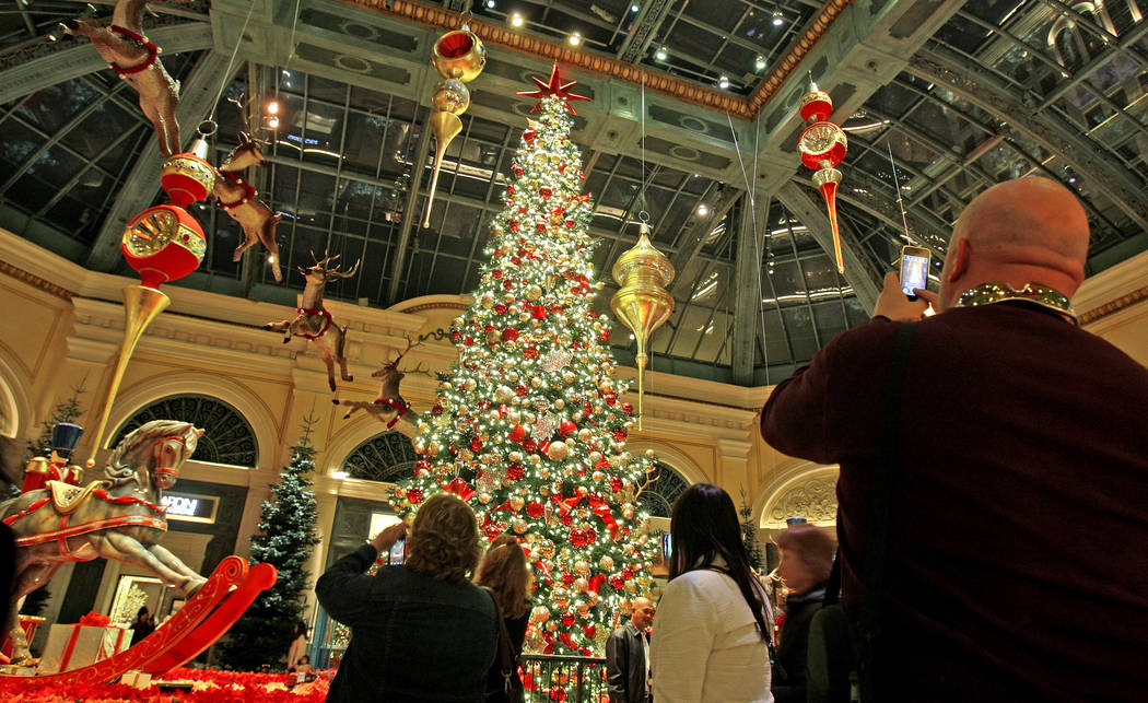 Visitors enjoy the Bellagio Conservatory & Botanical Garden Dec. 3, 2010. John Gurzinski/La ...