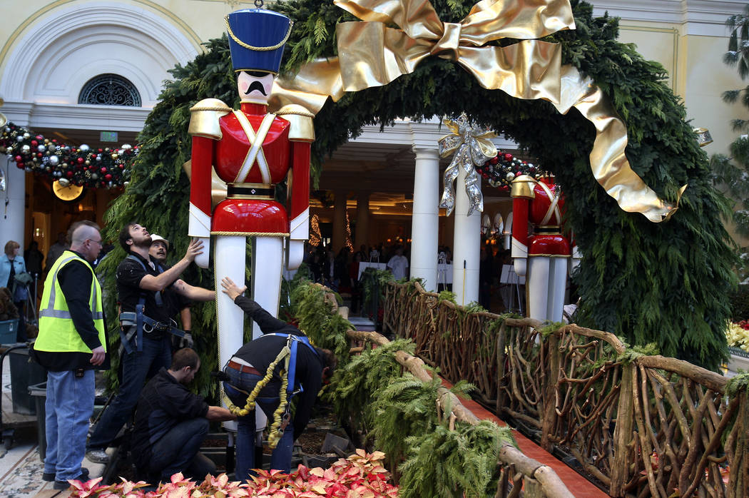 Workers arrange a wooden soldier figure Dec. 5, 2008, in preparation of the Bellagio Conservato ...