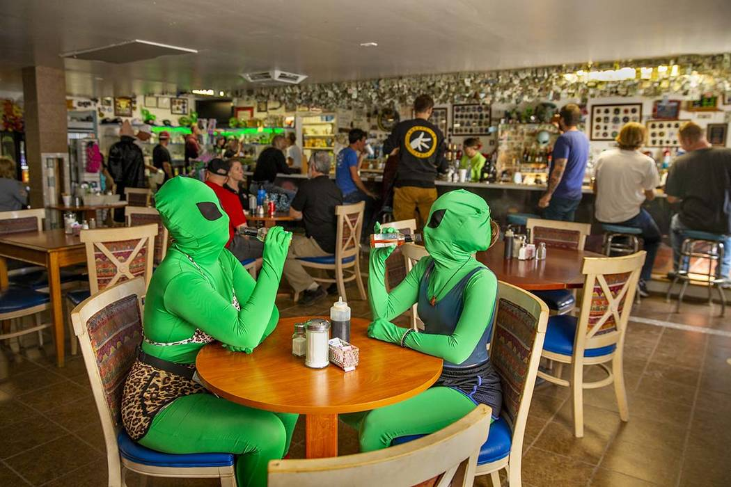 Invader Q-Tip, left, and Invader Stink enjoy a hot sauce breakfast at the Little A'Le'Inn Resta ...