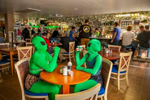 Invader Q-Tip, left, and Invader Stink enjoy a hot sauce breakfast at the Little A'Le'Inn Resta ...