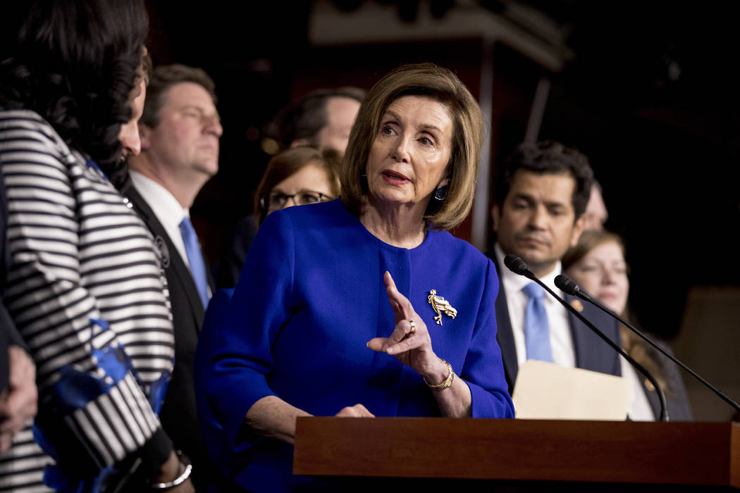 House Speaker Nancy Pelosi of Calif., accompanied by House Congress members speaks at a news co ...