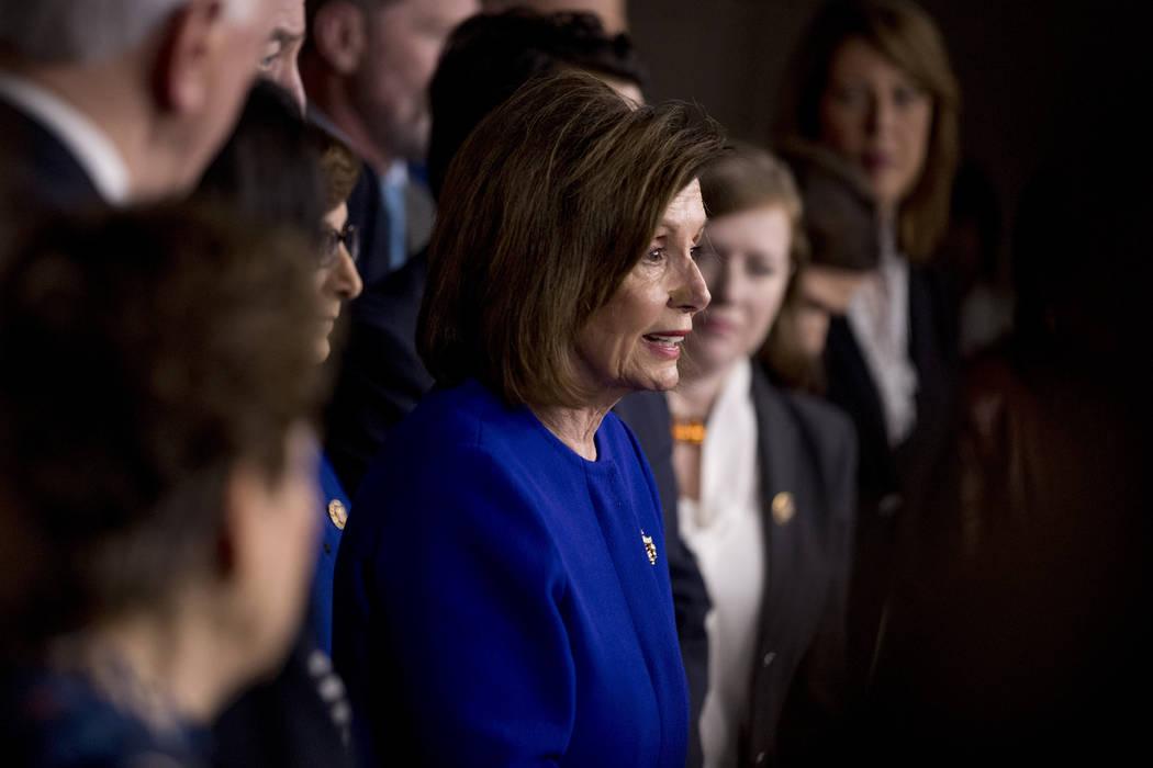 House Speaker Nancy Pelosi of Calif., accompanied by House Congress members, speaks at a news c ...