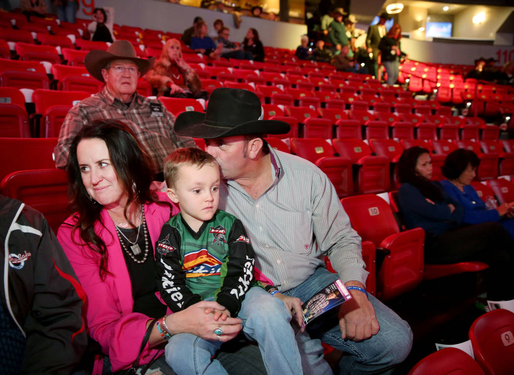 Missi Henderson, 43, of Winfield, Kan., takes her seats with son Murphy, 4, and husband Shane, ...