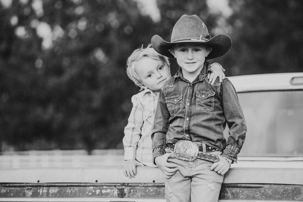 Max Henderson, right, with his brother Murphy, 4. Max, 7, died practicing roping in September, ...