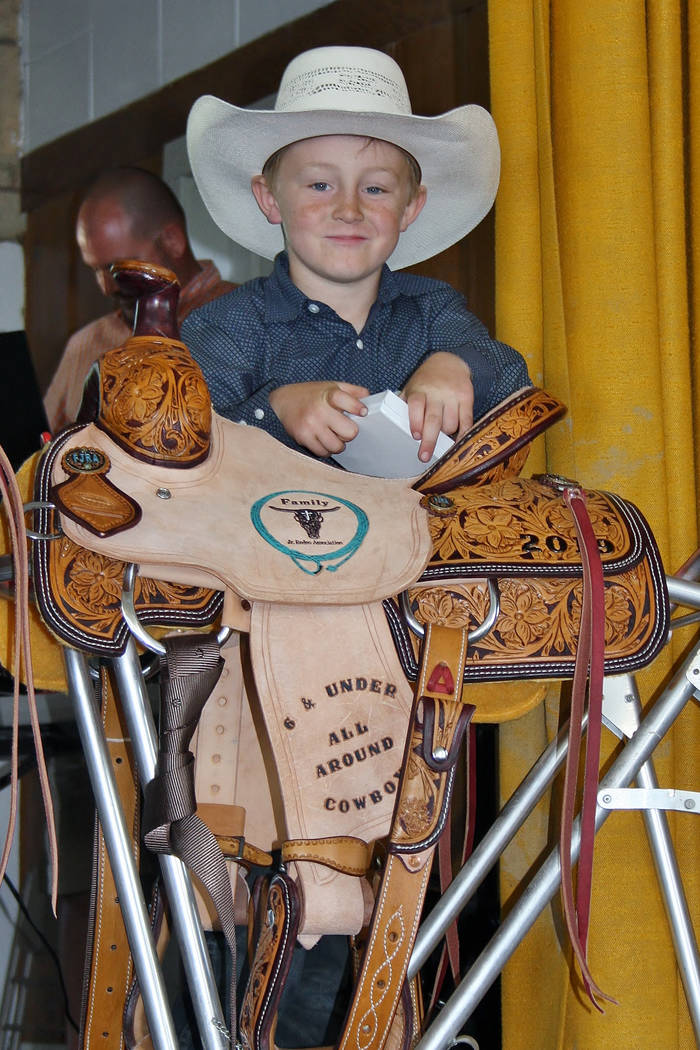 Max Henderson with his trophy saddle that he was awarded on June 2, 2019, for winning the Famil ...