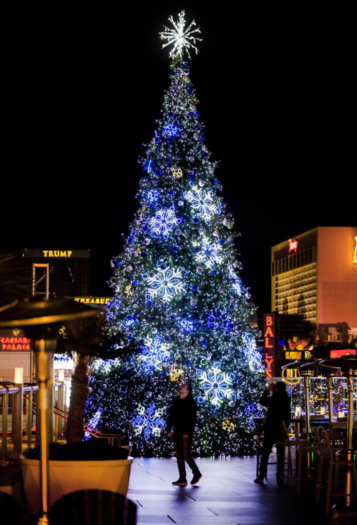 The giant Christmas tree is a visual backdrop about the ice rink at The Cosmopolitan of Las Veg ...
